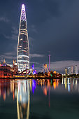Wonderful night view of skyscraper reflected in lake, Seoul