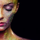 Portrait of beautiful woman with sparkles on her face