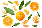mandarin with slices and green leaf isolated on white background top view