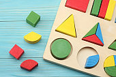 colorful wooden cubes on blue wooden background. Top view. Toys in the table