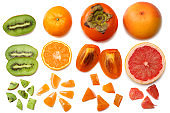 healthy food. mix sliced persimmon, orange, mandarin, kiwi fruit and grapefruit with green leaf isolated on white background. top view