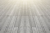 The surface with elongated rectangular stone tiles of gray color goes into perspective.
