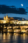 Prague Castle with charle's bridge in twilight with dramatic sky. Prague, Czech Republic