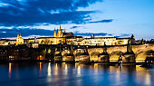 Prague Castle, charle's bridge and St. Vitus cathedral in twilight with dramatic sky. Prague, Czech Republic
