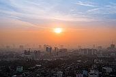 Foggy sunrise over city, two tone sky