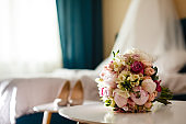 Wedding bouquet of pink roses and peony