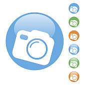 color round simple illustration of a camera icon