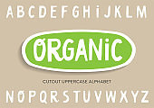 Vector cutout uppercase alphabet for bio packaging, organic production.