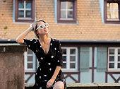 girl sitting on bridge in Strasbourg