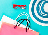 Shopping bags and eyeglasses with hat