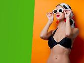 Portrait of beautiful style woman in bikini