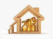 Wooden house icons of various sizes with coins and 2019