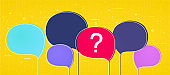 Big colorful speech bubbles with a question mark on yellow background.
