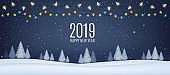 Winter night landscape with fir trees, coniferous  snowy forest, falling snow and luminous garlands. Holiday winter forest Merry Christmas and Happy New Year.