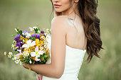 Wedding details, fashion bridal bouquet in hands of bride