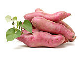 Leaves (Kumara) separated into sweet potatoes and white background