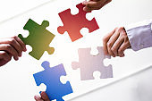 Group  asian business  of hands holding Primary colors jigsaw, Concept teamwork  success.