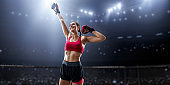 Female MMA fighter rejoices in victory in professional boxing ring