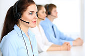 Call center operators. Focus at  business woman in headse