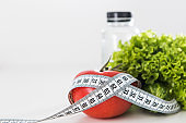 Dieting, tape measure with vegetables and water