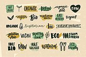 Collection of healthy organic food and natural vegan and vegetarian eco products lettering handwritten with calligraphic fonts. Bundle of hand drawn labels or tags.