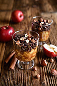 Baked apple pieces topped with chocolate granola and hazelnuts