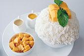 Bingsu mango (Korean Desserts) Shaved ice desserts with mango on top