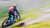 Motion blurred mountain biker going fast