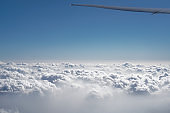 View in the illuminator box during the flight. Travel by airliner with a beautiful cloud landscape. Stock photos