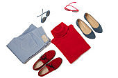 Fashion set of blue jeans, red sweater, shoes and sunglsses on isolated background.