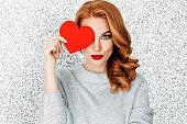 Beautiful woman cardboard heart