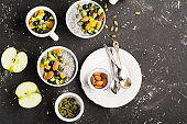 Healthy breakfast or morning snack with chia seeds pudding and berries on gray concrete stone background, vegetarian food, diet and health concept