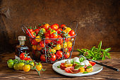 Caprese salad with colorful cherry tomatoes