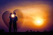 Romantic love at sunset