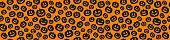 Halloween - seamless texture with funny pumpkins. Vector.