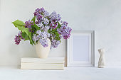Mockup with a white frame and lilac branches