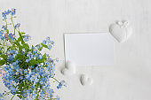Mockup white greeting card with blue flowers