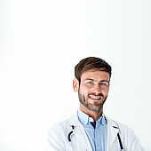 Portrait of smiling mid adult male doctor
