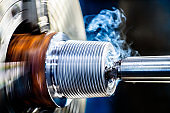 Close-up of lathe machine in metal industry