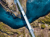 Driving on a bridge over deep blue water