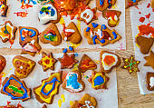 Colorful icing on Christmas gingerbread cookies