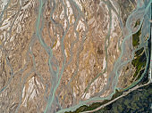 Aerial shot of river at volcanic landscape