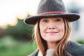 Portrait of confident mature woman wearing hat