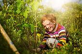 Portrait of happy girl planting on field