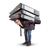 Man carrying a giant stack of folders