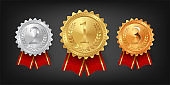 Gold, silver and bronze medals with red ribbons isolated on black background. Vector design element.