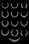Laurel wreaths isolated on black background. Vector design elements.