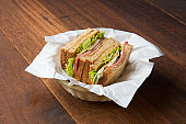 ham sandwich with wood background