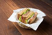 ham sandwich with wood background