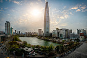 Cityscape of Seoul downtown city skyline with cherry blossom
